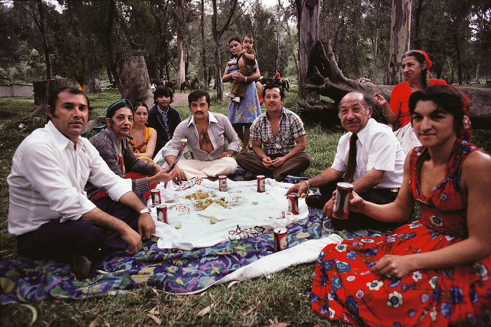 A gypsy family drinking Tecate beer at a picnic in a park in Zochimilco, Mexico.