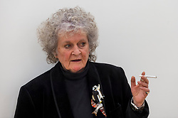 © Licensed to London News Pictures. 14/10/2020. LONDON, UK. Artist Maggi Hambling poses at the preview of Maggi Hambling: 2020 at Malborough Gallery in Mayfair.  The exhibition of recent paintings coincides with Hambling's 75th Birthday and runs 15 October to 21 November 2020.  Photo credit: Stephen Chung/LNP