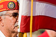 28 MAY 2007 -- PHOENIX, AZ: A member of the Marine Corps League carries the American flag during the Memorial Day ceremony at the National Memorial Cemetery in Phoenix, AZ, Monday.  Photo by Jack Kurtz/ZUMA Press