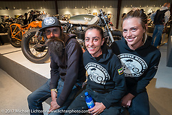 Show particpants and custom builders J Shia of Madhouse Motors with a friend at the Old Iron - Young Blood exhibition media and industry reception in the Motorcycles as Art gallery at the Buffalo Chip during the annual Sturgis Black Hills Motorcycle Rally. Sturgis, SD. USA. Sunday August 6, 2017. Photography ©2017 Michael Lichter.