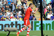 Southampton's Rickie Lambert celebrates after he scores his sides 1st goal. Barclays Premier league match, Swansea city v Southampton at the Liberty stadium in Swansea, South Wales on Saturday 3rd May 2014.<br /> pic by Phil Rees, Andrew Orchard sports photography.