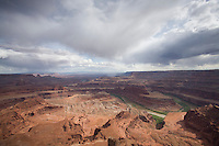 Scenic view of Dead Horse State Park with thunderclouds near Moab, Utah.
