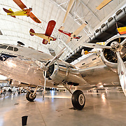 Wide shot of the Clipper Flying Cloud on display at the Smithsonian National Air and Space Museum's Udvar-Hazy Center, a large hangar facility at Chantilly, Virginia, next to Dulles Airport and just outside Washington DC.