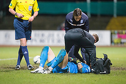 Ross County's keeper Antonio Reguero gets treatment for a head knock. <br /> Dundee 1 v 1 Ross County, SPFL Premiership game player 4/1/2015 at Dundee's home ground Dens Park.