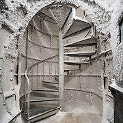 At the end of the utility ice tunnels at South Pole is this spiral stair covered in ice crystals that leads up to the surface about 70 feet above. It's a strange site from above too, a tube with a door sitting out on the Ice.
