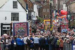 © Licensed to London News Pictures. 09/07/2016. Durham, UK. The procession of banners and bands make there way though Durham during the Durham Miners' Gala in County Durham, UK. The gala is a large gathering held annually associated with the coal mining heritage and trade unionism. Photo credit : Ian Hinchliffe/LNP