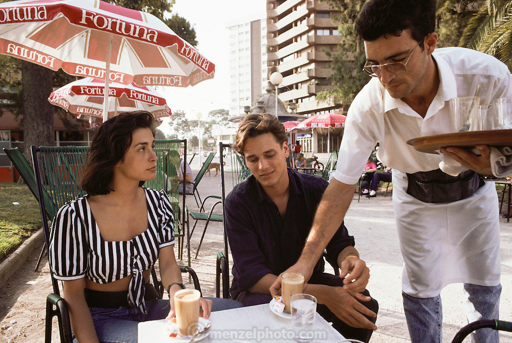Gemma Sastre and  Eino Brand at a café having cafes con leche in Valencia, Spain. MODEL RELEASED.