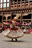 Dancer with mask performing during the Trongsa Dzong Festival in Bhutan, Asia