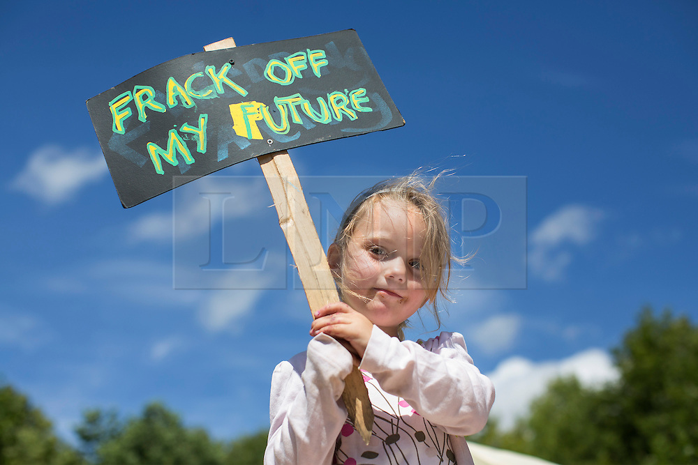© licensed to London News Pictures. London, UK 04/08/2013. Jessica Pawson, a 4 year-old girl protesting against oil exploration in Balcombe, West Sussex on Sunday, August 04, 2013, after energy company Cuadrilla began drilling at the site two days ago. Photo credit: Tolga Akmen/LNP