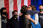 03 NOVEMBER 2020 - DES MOINES, IOWA: THERESA GREENFIELD, the Democratic candidate for the US Senate, (right) hugs her twin sister MARIA AMMEND (back to camera) while delivering her concession speech at the Renaissance Des Moines Savery Hotel after her loss in the race for the US Senate. Greenfield conceded to incumbent Republican Sen. Joni Ernst at about 11:45PM November 3.      PHOTO BY JACK KURTZ