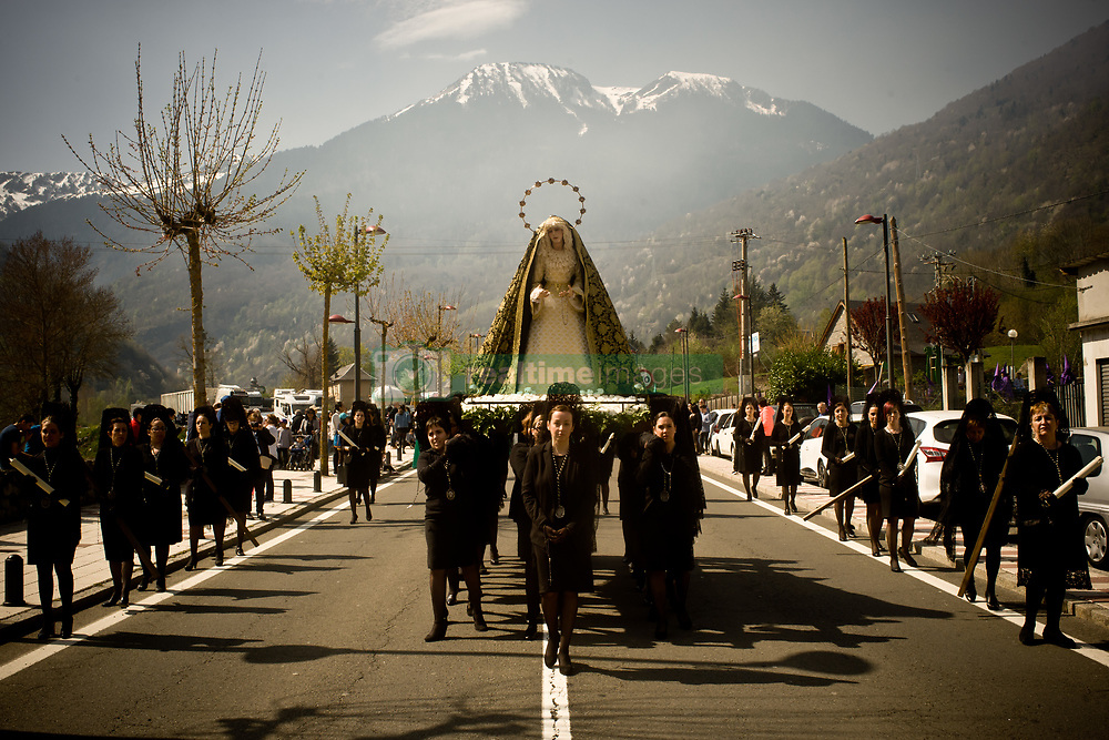 April 14, 2017 - Bossost, Lleida, Spain - In the aranes village of Bossost women wearing mantillas carry the image of Virgin Mary during the Holy Friday procession. In the village of Bossost, Pyrenees mountains at Vall d'Aran region, neighbours take to the streets every year to held the holy friday procession. Bossost is the unic  village that still holds this tradition in the Vall d'Aran region and has its origins from 1879. (Credit Image: © Jordi Boixareu via ZUMA Wire)