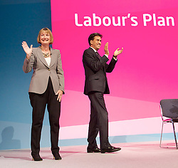 Labour Party Conference<br /> at Manchester Central, Manchester, Great Britain <br /> 24th September 2014 <br /> <br /> Red flag song and finale of the conference <br /> <br /> with Harriet Harman MP <br /> deputy Leader of the Labour Party <br /> and Ed Miliband <br /> <br /> Photograph by Elliott Franks <br /> Image licensed to Elliott Franks Photography Services