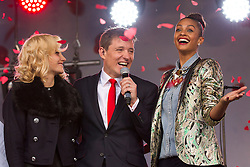 © Licensed to London News Pictures. 24/10/2012. LONDON, UK. TV presenter Ben Shephard, singer Pixie Lott (L) and X-Factor judge Alesha Dixon (R) are showered with poppies at the launch of the Royal British Legion's 2012 Poppy Appeal in Trafalgar Square, London, today (24/10/12).  Photo credit: Matt Cetti-Roberts/LNP