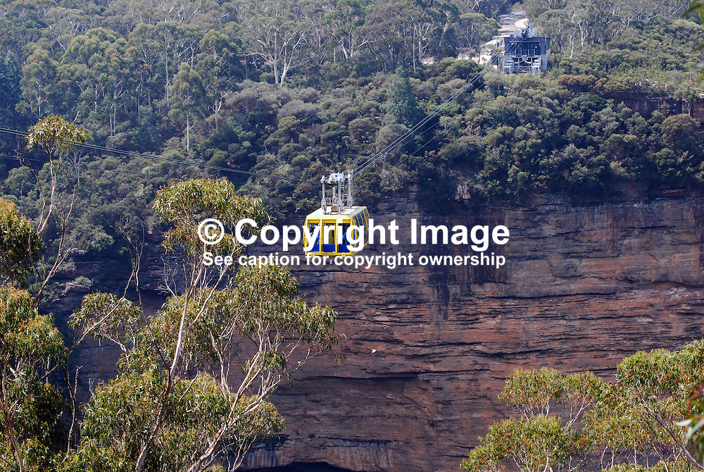 Scenic Skyway, Blue Mountains, New South Wales, Australia, takes you on a 720 metre journey, 270m above ancient ravines and dazzling waterfalls.  You are suspended over Jurassic rainforests as you glide smoothly across the sky. This ride boasts a world first - an Electro-Sceniglass floor.  At the flip of a switch, breathtaking views are revealed through the cabin floor..The 360 degree bird's eye view from the Skyway takes in the Three Sisters, Katoomba Falls, Mount Solitary and the Jamison Valley. 201003273475.<br />