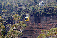 Scenic Skyway, Blue Mountains, New South Wales, Australia, takes you on a 720 metre journey, 270m above ancient ravines and dazzling waterfalls. You are suspended over Jurassic rainforests as you glide smoothly across the sky. This ride boasts a world first - an Electro-Sceniglass floor. At the flip of a switch, breathtaking views are revealed through the cabin floor..The 360 degree bird's eye view from the Skyway takes in the Three Sisters, Katoomba Falls, Mount Solitary and the Jamison Valley. 201003273475...Copyright Image from Victor Patterson, 54 Dorchester Park, Belfast, UK, BT9 6RJ..Tel: +44 28 9066 1296.Mob: +44 7802 353836.Voicemail +44 20 8816 7153.Skype: victorpattersonbelfast.Email: victorpatterson@mac.com.Email: victorpatterson@ireland.com (back-up)..IMPORTANT: If you wish to use this image or any other of my images please go to www.victorpatterson.com and click on the Terms & Conditions. Then contact me by email or phone with the reference number(s) of the image(s) concerned.