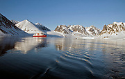 """Magdalenefjord at 79 degrees N in north-western Spitsbergen, Svalbard. The exploring vessle """"Polar Star"""" is anchored here this early morning in June."""