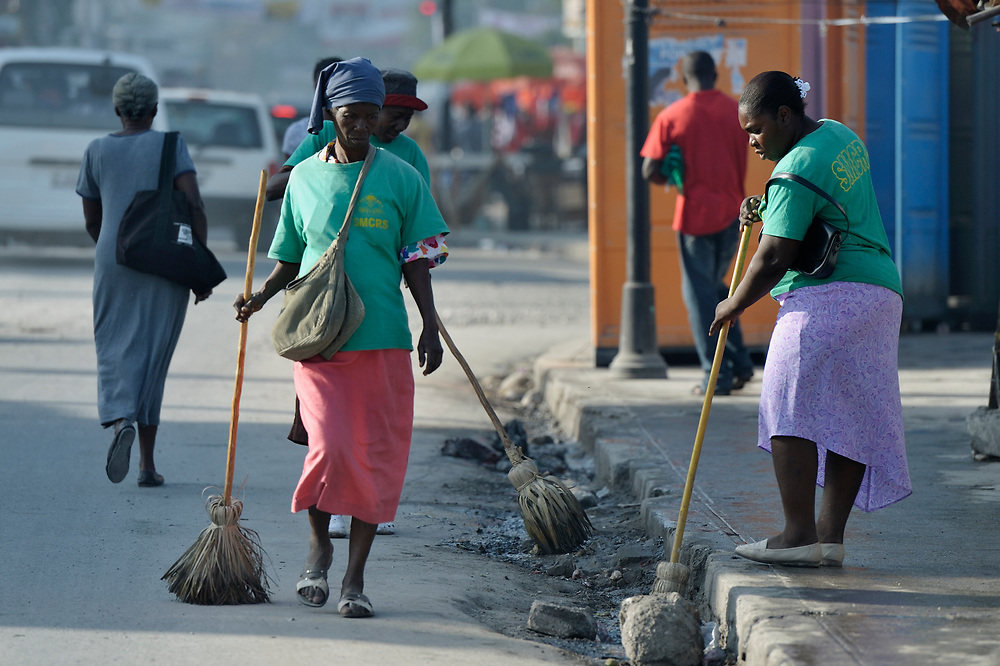 Women street sweepers in Port-au-Prince, Haiti.