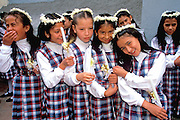 ECUADOR, HIGHLANDS, CUENCA girls in line for 1st Communion