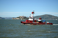Guardian Fire Boat No 2, operated by San Francisco Fire Department, San Francisco, California, USA, on San Francisco Bay with the former prison at Alcatraz in the background. 201304131470<br /> <br /> Copyright Image from Victor Patterson, 54 Dorchester Park, Belfast, UK, BT9 6RJ<br /> <br /> Tel: +44 28 9066 1296<br /> Mob: +44 7802 353836<br /> Voicemail +44 20 8816 7153<br /> Skype: victorpattersonbelfast<br /> Email: victorpatterson@me.com<br /> Email: victorpatterson@ireland.com (back-up)<br /> <br /> IMPORTANT: If you wish to use this image or any other of my images please go to www.victorpatterson.com and click on the Terms & Conditions. Then contact me by email or phone with the reference number(s) of the image(s) concerned.