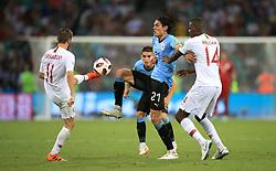 Peru's Raul Ruidiaz (left) and Uruguay's Edinson Cavani (centre) battle for the ball