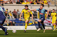 Luke Garbutt of Oxford United under pressure from Michael Harriman of Wycombe Wanderers during the EFL Sky Bet League 1 match between Oxford United and Wycombe Wanderers at the Kassam Stadium, Oxford, England on 30 March 2019.