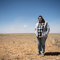 Navajo Technical University Associate Professor of Biology and Microbiology Dr. Irene A. Anyangwe stands for a portrait in Nahodishgish (Dalton Pass) near Crownpoint Thursday, April 15.