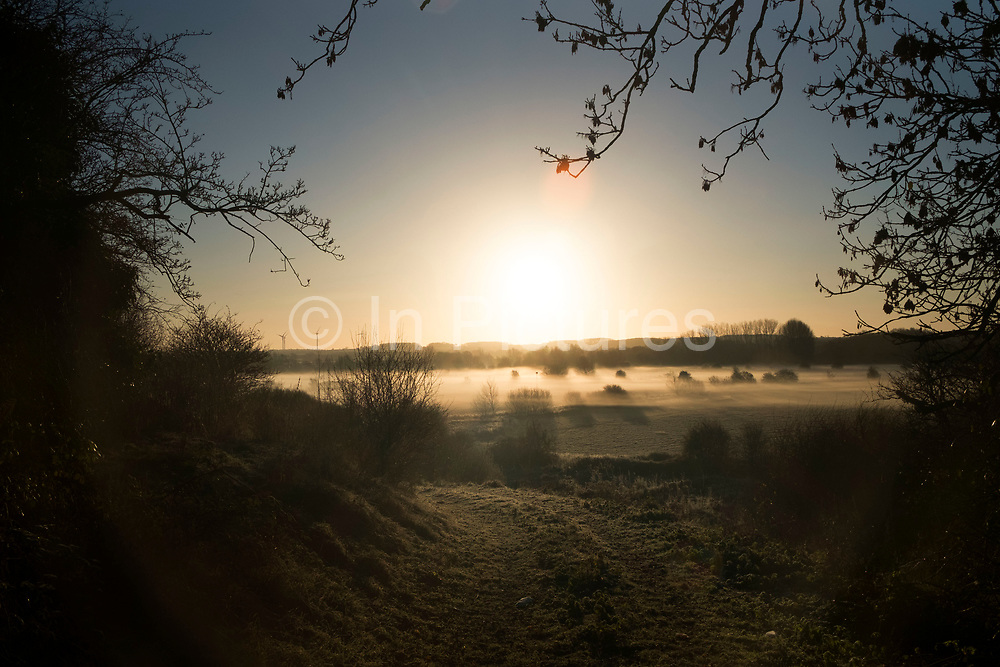 Frosty winter morning mist landscape at sunrise in Olney, England, United Kingdom. (photo by Mike Kemp/In Pictures via Getty Images)