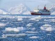 The M/S Explorer cruises through sea ice in Antarctica in February 2005. The M/S Explorer sank after hitting an iceberg in 2007, and now lies sunk 600 meters deep in the Southern Ocean. The Explorer, owned by Canadian travel company GAP Adventures, took on water after hitting ice at 12:24 AM EST on Friday November 23, 2007. 154 passengers and crew calmly climbed into lifeboats and drifted some six hours in calm waters. A Norwegian passenger boat rescued and took them to Chile's Antarctic Eduardo Frei base, where they were fed, clothed, checked by a doctor, and later flown to Punta Arenas, Chile. The ship sank hours after the passengers and crew were safely evacuated.