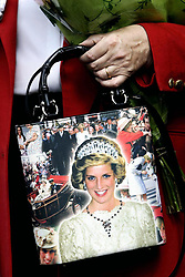 Members of the public arrive at Kensington Palace, to mark the ninth anniversary of the death of Diana, Princess of Wales.