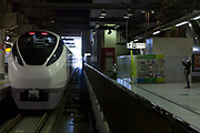 A man takes a photo of a E657 series Tokiwa express train (K16) at Ueno station  Tokyo, Japan. January 31st 2014