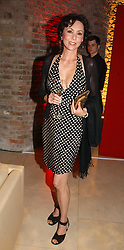 Model MARIE HELVIN at a party to celebrate 100 years of Chinese Cinema hosted by Shangri-la Hotels and Tartan Films at Asprey, New Bond Street, London on 25th April 2006.<br /><br />NON EXCLUSIVE - WORLD RIGHTS