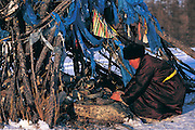 Darkhad woman & Ovoo<br /> Lighting incense<br /> Darkhad Depression<br /> Northern Mongolia