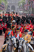 """The queens party returns down the Mall - Trooping the Colour by the Irish Guards on the Queen's Birthday Parade. The Queen's Colour is """"Trooped"""" in front of Her Majesty The Queen and all the Royal Colonels.  His Royal Highness The Duke of Cambridge takes the Colonel's Review for the first time on Horse Guards Parade riding his horse Wellesley. The Irish Guards are led out by their famous wolfhound mascot Domhnall and more than one thousand Household Division soldiers perform their ceremonial duty. The Soldiers will parade in the traditional ceremonial uniforms of the Household Cavalry, Royal Horse Artillery, and Foot Guards. They are accompanied by the Household Division Bands & Corps of Drums. London 17th June 2017."""