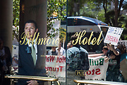 The doorman watches the activists gathering in front of Millennium Biltmore Hotel where US Attorney General Jeff Sessions is speaking during his visit to Los Angeles, California on June 26th, 2018.