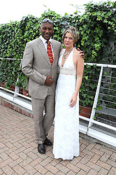 Actor COLIN SALMON and FIONA HAWTHORNE at the 3rd day of the 2008 Glorious Goodwood racing festival at Goodwood Racecourse, West Sussex on 31st July 2008.<br /> <br /> NON EXCLUSIVE - WORLD RIGHTS