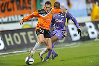 FOOTBALL - FRENCH CHAMPIONSHIP 2009/2010 - L1 - FC LORIENT v TOULOUSE FC - 14/02/2010 - PHOTO PASCAL ALLEE / DPPI - MORGAN AMALFITANO (FCL) / MOHAMED FOFANA (TFC)