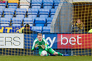 Wimbledon goalkeeper Aaron Ramsdale (35), on loan from Bournemouth, saves during the EFL Sky Bet League 1 match between Shrewsbury Town and AFC Wimbledon at Greenhous Meadow, Shrewsbury, England on 2 March 2019.