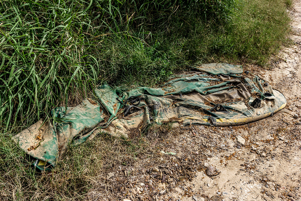 Discarded rafts used by migrants to cross the Rio Grande River, found on the USA side in Roma, Texas, USA