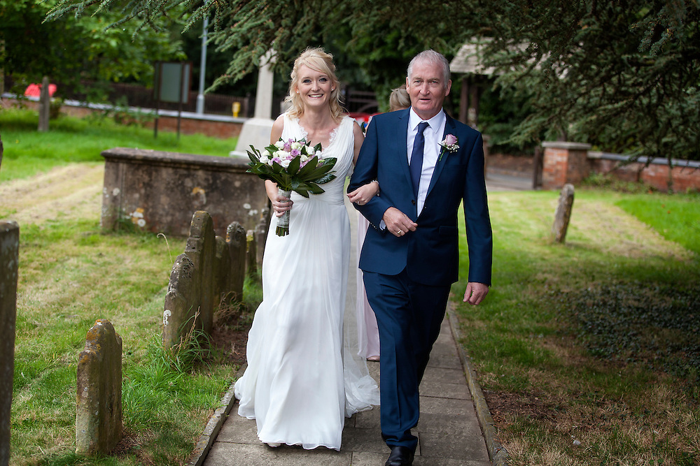 Jo and her father walk up the path to the Church