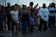 Protesters stand at Joyce Kelly Comstock Elementary School in response to an incident with teens and police officers at a community pool in McKinney, Texas on June 8, 2015.  (Cooper Neill for The New York Times)