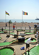 licensed to London News Pictures. BRIGHTON  UK. 21/04/11. People play crazy golf. People flock to Brighton Beach today to catch the sunshine before the start of the Easter Bank Holiday in Britain. Temperatures are set to continue to rise over the weekend. Photo credit should read Stephen Simpson/LNP