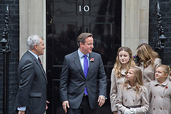 © licensed to London News Pictures. London, UK 07/11/2013. Prime Minister David Cameron welcoming The Poppy Girls, members of the armed forces and supporters of the Poppy Appeal to Downing Street. Photo credit: Tolga Akmen/LNP