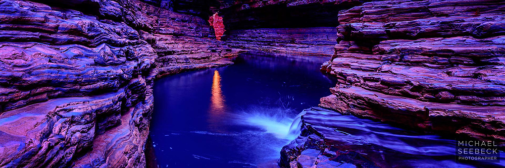 A small waterfall flows into a beautiful blue pool in a gorge in Karinjini NP in the Pilbara.<br /> <br /> Code: HAWP0005<br /> <br /> Limited Edition of 125 Prints