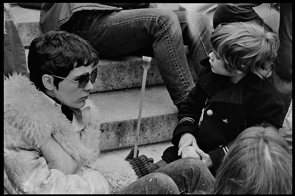 Madison, WI – May, 1970. Protesters against the war in Vietnam at the Capitol, led by Veterans for Peace in Vietnam On May 1, 1970, there was a general student strike in response to the news that the U.S. had expanded bombing into Cambodia. There was a march against the war, led by Veterans for Peace in Vietnam; and after the May 4 shootings at Kent State University in Ohio, there were more protests at UW Madison, which led to the police being called in, and teargassing demonstrators in the streets and on campus. A woman and children on the steps of the State Capitol.
