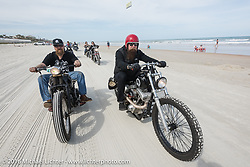 Bill Dodge (L) with Jim Root from the Band Slipknot, both on Bill's Blings Cycles bikes, riding on Daytona Beach during Daytona Bike Week 75th Anniversary event. FL, USA. Thursday March 3, 2016.  Photography ©2016 Michael Lichter.