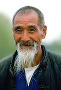 An old man with grey beard in Xian, China