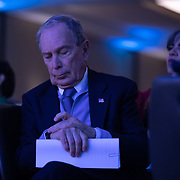 CHARLOTTE, NC - FEBRUARY 29: Former New York City Mayor and 2020 presidential candidate, Michael Bloomberg checks his watch as he waits to speak to attendees at the Blue NC Celebration, a dinner put on by the North Carolina Democratic Party at the Hilton in University City in Charlotte, NC on February 29, 2020. The 2020 presidential candidate speaks as polls begin to close in the neighboring South Carolina primary. (Photo by Logan Cyrus for AFP)