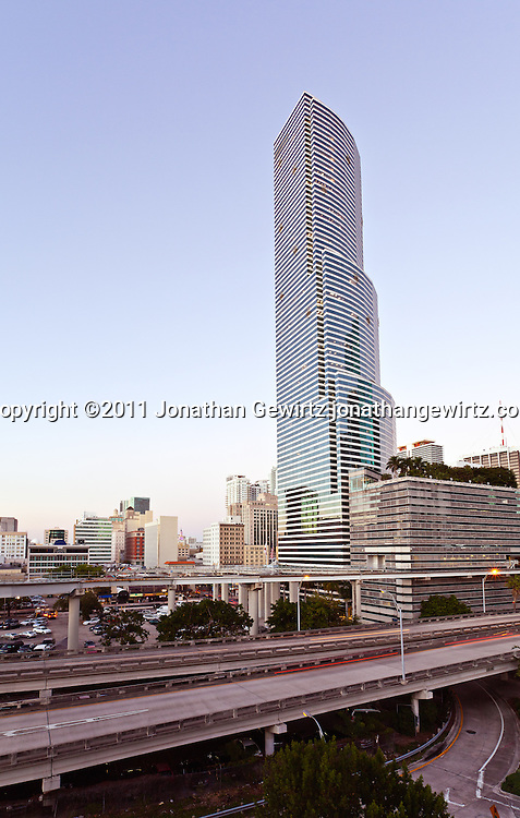 Twilight view of the Miami Tower and Miami's downtown commercial and hotel district, expressway ramps to US Route 95 and Metromover elevated rail tracks. WATERMARKS WILL NOT APPEAR ON PRINTS OR LICENSED IMAGES.