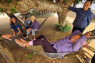 The old ladies hanging out together in the shade, in the harbour where the Maritime Silk Road started, during many centuries, near Xu Wen, Guangdong province, China