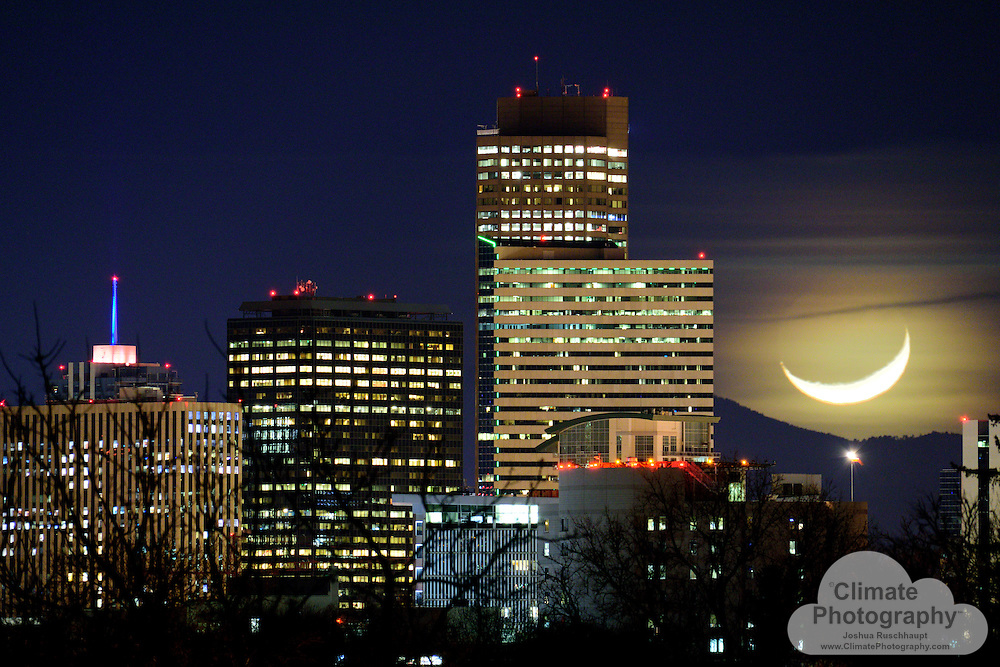 Moon setting over Denver.
